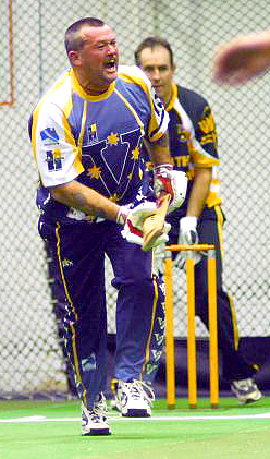 Peter Neville playing for the Victorian State indoor cricket team